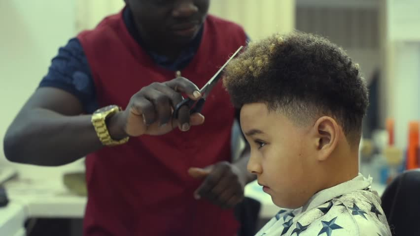 Boy In The African Barbershop Stock Footage Video 100 Royalty Free 1024339427 Shutterstock