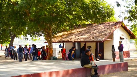 Ahmedabad, Gujarat, India - Circa 2018: Visitors on the huts of the sabarmati ashram in Gujarat India, which has multiple exhibits of how Mahatma Gandhi lived, his belongings and lifestyle. This