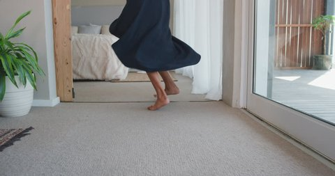 happy woman jumping on bed in hotel room having fun successful lifestyle celebrating enjoying luxury penthouse apartment