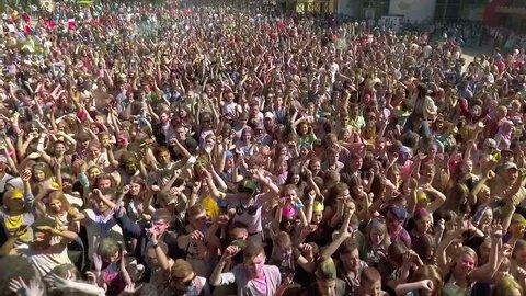 Kharkiv, Ukraine - Apr 30, 2017: aerial of happy people dancing at Holi festival