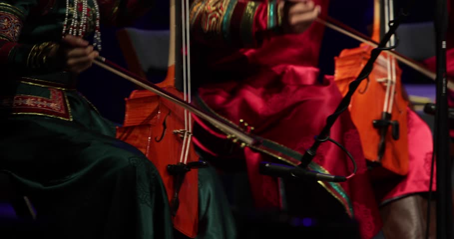 Footage of a Chinese orchestra playing traditional music on the occasion of the Chinese new year | Shutterstock HD Video #1024490567