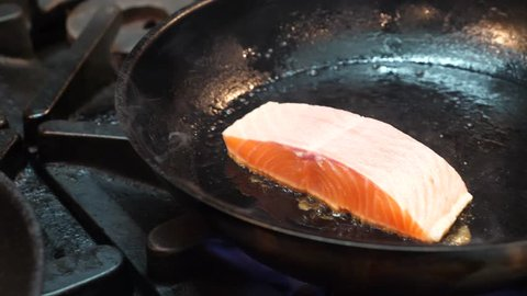 Tasmanian Salmon Being Cooked On Gas Stove Fry Pan In Commercial Kitchen, Handheld