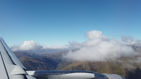View from the airplane of Queenstown New Zealand, Airplane wing, fly pass cloud and mountains