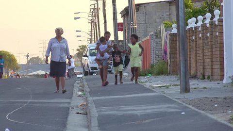 GUGULETHU, SOUTH AFRICA - CIRCA 2018 - People walk on the streets in the Gugulethu township in South Africa.
