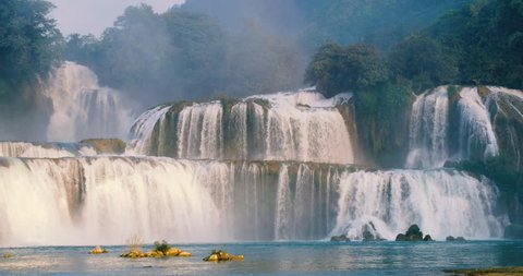 Beautiful waterfall. Ban Gioc waterfall or Detian waterfall is landmarks name of two waterfalls in border Cao Bang, Vietnam and Daxin County, China. Stock video footage  Amazing landscape for travel
