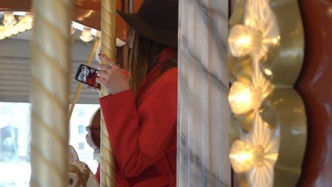 Close Up Of Beautiful Happy Woman Having Fun Riding Carousel In Amusement