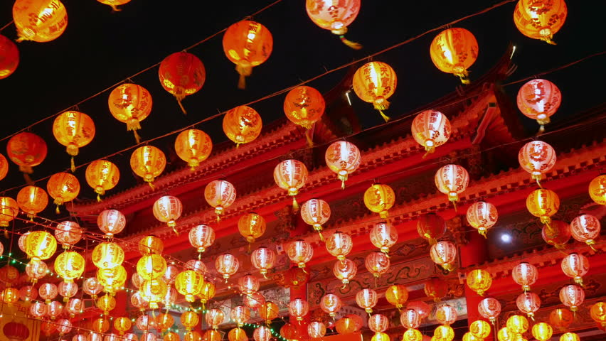 Chinese red lantern illuminated hanging for chinese new year at night. | Shutterstock HD Video #1024624067