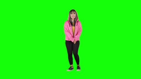 Attractive female modern style dancer performing in the studio. Shot in 4k resolution with green screen background