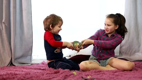 the conflict between a boy and a girl. the kids are fighting, the boy takes the girls toy. sibling relationships. the baby is crying. The child bites. Older kids bullied younger