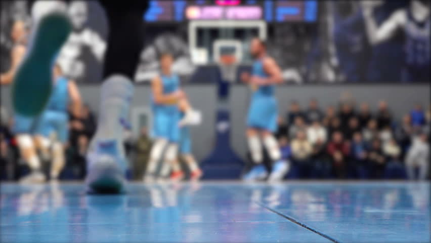 Basketball game video shooting below,  players out of focus | Shutterstock HD Video #1024696607