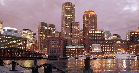 Downtown city view of Boston Massachusetts looking of the riverfront harbor at night