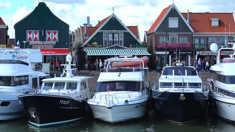 Volendam, Netherlands - August 18, 2018: Tourist ship coming to the pier of Volendam. 4K.