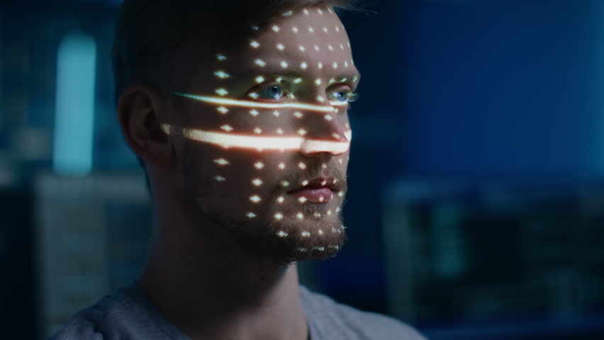 Handsome Young Caucasian Man is Identified by Biometric Facial Recognition Scanning Process. Futuristic Concept: Projector Identifies Individual by Illuminating Face by Dots and Scanning with Laser
