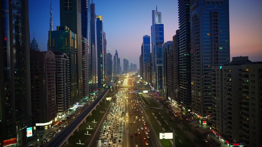 Spectacular downtown Dubai modern architecture building in pink evening sunset night illumination on 4k aerial ciytscape | Shutterstock HD Video #1024898057