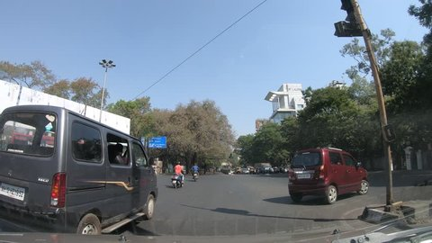 Pune, India - March 02 2019: Time lapse of driving through the streets of Pune India.