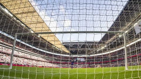 London, England - March 02 2019: time laps behind door during the Premier League match between Tottenham Hotspur and Arsenal at Wembley Stadium