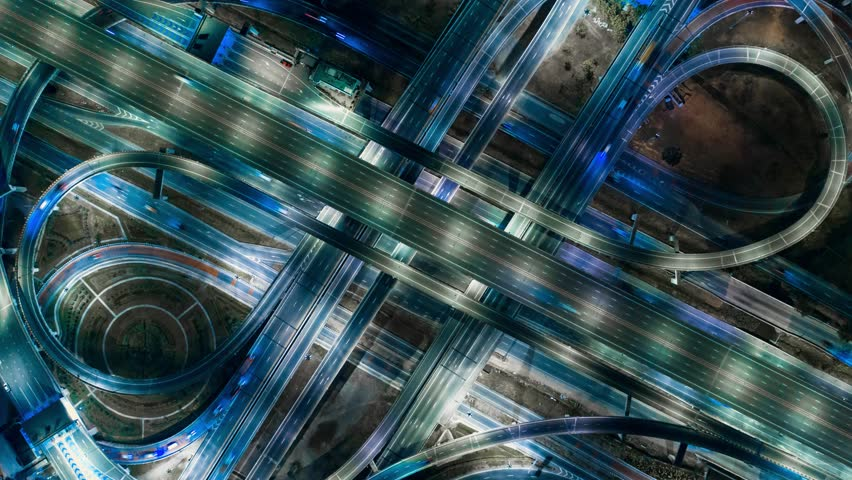 Hyper Time Lapse of Aerial View of Busy Highway Road Junctions at Night from a drone. The Intersecting Freeway Road Overpass The Eastern Outer Ring Road. | Shutterstock HD Video #1025109137