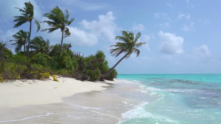 Tropical Sandy Beach of the Deserted Island Innafushi in Baa Atoll, Maldives | Shutterstock HD Video #1025163617