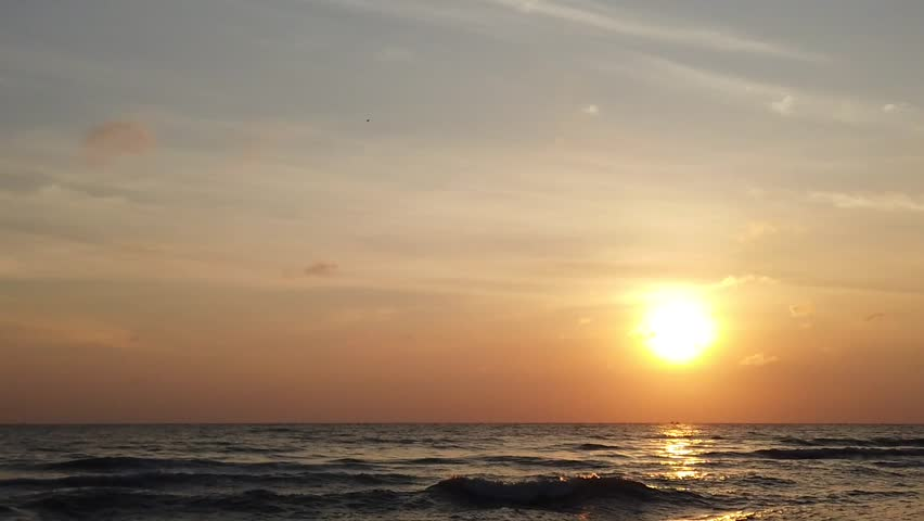 Beautiful sunrise tropical beach. With noise blurry background. Slowmotion shot. | Shutterstock HD Video #1025193437