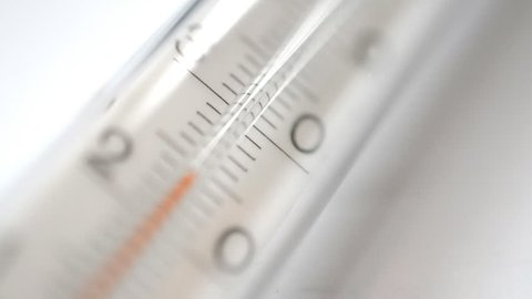 Thermometer on white background HD stock footage