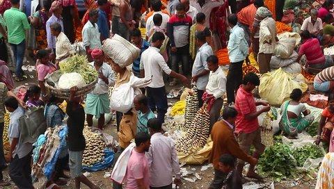 Kolkata, India - Circa March 2019. Customers and traders of huge Mullik Ghat Flower Market on old indian street in Kolkata.
