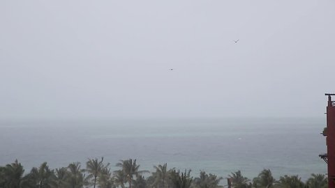 View from a Cancun resort looking out onto the ocean as a tropical storm bears down on the area.