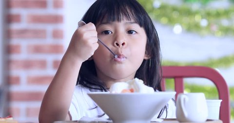 Cute Girl Eating Ice-Cream,little girl with ice cream on colorful background,Asian kid eating ice cream,Kid eating Sweets in cafe
