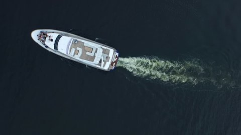 Motor boat sailing blue sea. Aerial view of luxury yacht racing deep water. Luxury ship journey. Travel holiday on white yacht