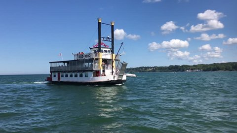 ROCHESTER, NY - SEPTEMBER 16: Harbor Town Belle ship in Lake Ontario of Rochester, New York on September 16, 2018.