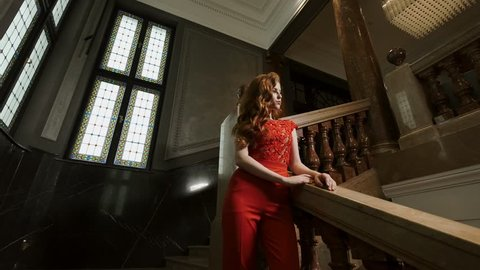 Gorgeous Models Posing In A Stylish Building. Decorative Railings In The Building. Tall French Windows.
