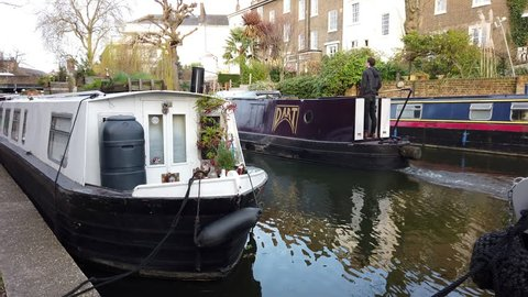 CAMDEN, LONDON - MARCH 11, 2019: A canal barge on the Regent's Canal in Camden, North London, UK.