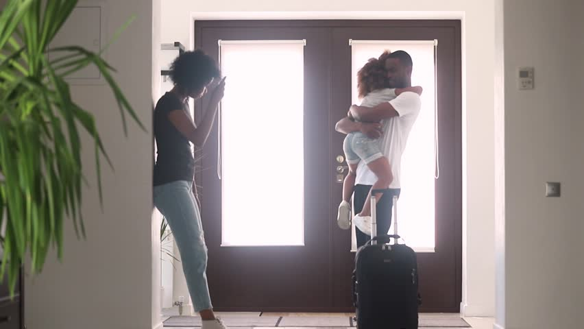 African dad talking to sad child daughter in hallway leaving family home with goodbye hug, black father embracing consoling kid say bye to upset little girl, parents divorce, shared custody concept | Shutterstock HD Video #1025577047