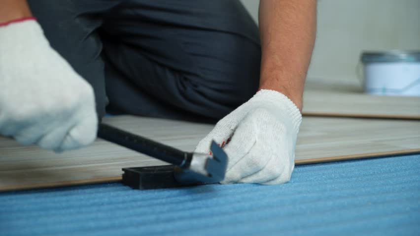 Builder renovating apartment. Repair of the apartment, laying laminate flooring. Construction. | Shutterstock HD Video #1025655917