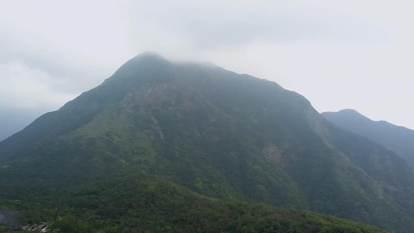 Misty over high mountain at Ngong Ping village, Hong Kong | Shutterstock HD Video #1025686157
