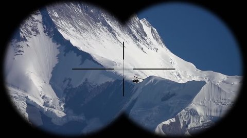 Deltaplan Flying over Highlands of Himalayan Mountains in Nepal Seen through Binoculars. Hiking, Mountaineering and Trekking