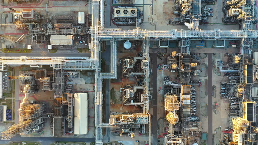 Aerial view of oil refinery and power plant with pipelines and storage tanks. | Shutterstock HD Video #1025738657