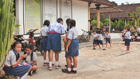 Nusa Lembomgan, Indonesia - January 15, 2019: Indonesian schoolchildren in the schoolyard.
