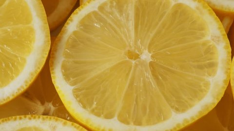 Lemon slices closeup, food summer background, fruits top view. Rotate