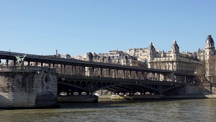 Boat traffic under Pont Bir-Hakeim (Passy viaduc) Metro traffic on the bridge - Paris, France   Shutterstock HD Video #1025799227