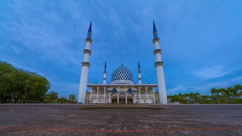 Low Angle Dramatic Sunrise Time Lapse with moonset at a mosque. Shah Alam, Malaysia. Night to day. Slide down motion timelapse.