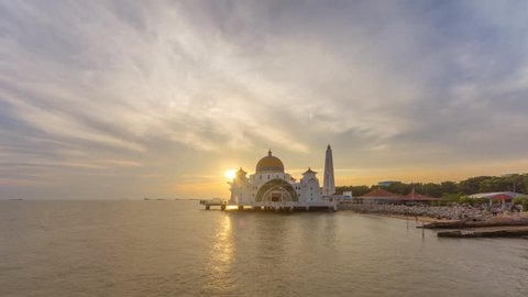 Time lapse on afternoon of scattered clouds at a floating Masjid Selat Melaka in Melaka, Malaysia.