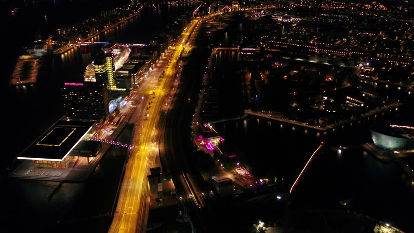 Aerial Netherlands Amsterdam June 2018 Night   Aerial video of central Amsterdam in the Netherlands at night. | Shutterstock HD Video #1025824217