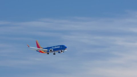 PHOENIX, AZ - 2019: Boeing 737-8 Max New Commercial Passenger Jet Airliner from Southwest Airlines flying in a Blue Sky on a Sunny Day