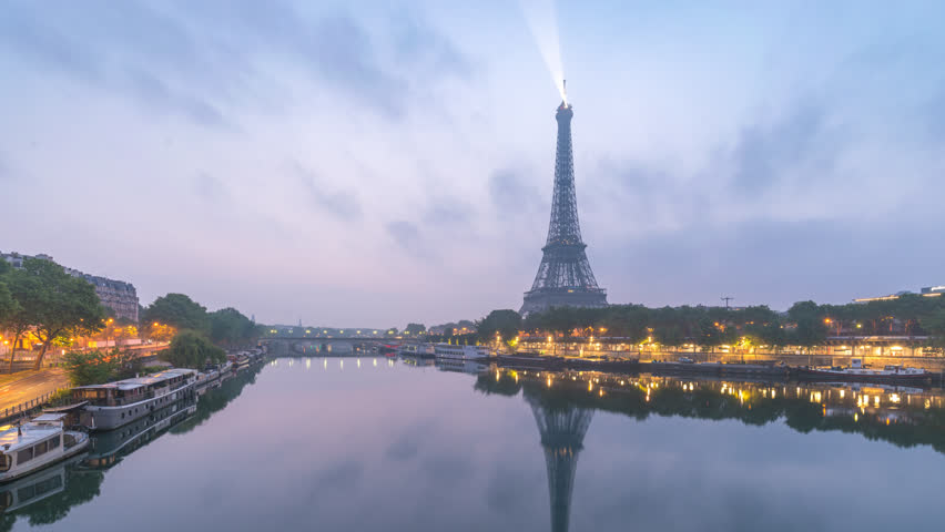 Paris France time lapse 4K, city skyline timelapse at Seine River and Eiffel Tower and Seine River   Shutterstock HD Video #1025838557