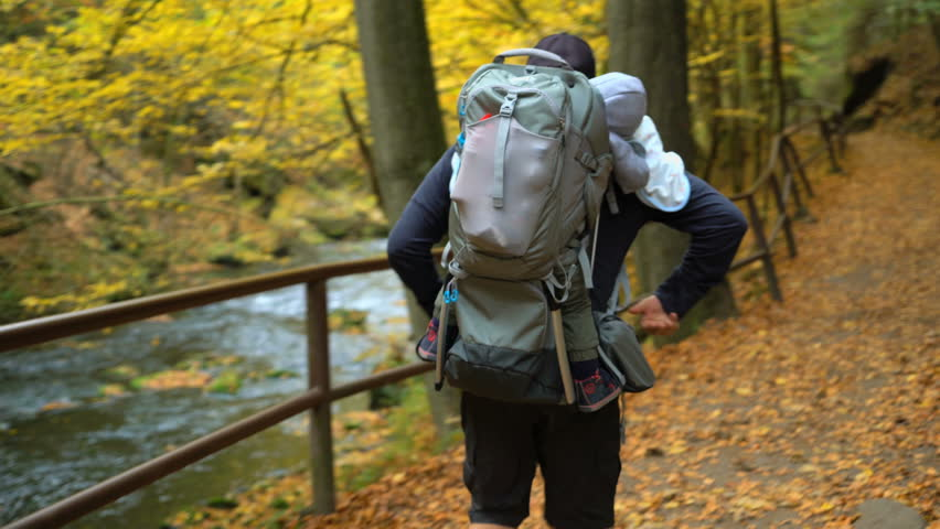 POV of father traveling in the wild nature with son in touristic backpack, tracking shot | Shutterstock HD Video #1025849237
