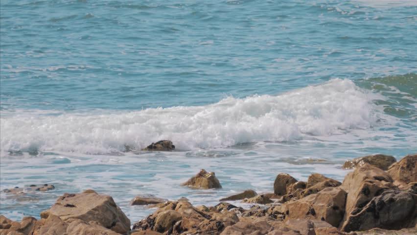 Ocean Waves breaking on rocks on beach, Portugal coast   Shutterstock HD Video #1025866697