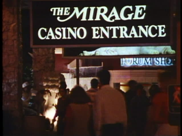 LAS VEGAS, NEVADA, 1994, Night on the Strip, entrance to Mirage Casino, crowd