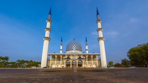 Low Angle Dramatic Sunrise Time Lapse with moonset at a mosque. Shah Alam, Malaysia. Slide down and zoom in motion timelapse.