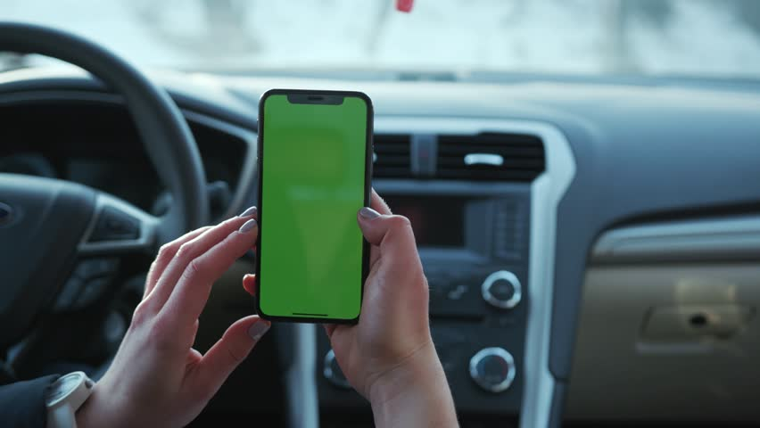 Paris, France - April 5, 2018: Hands holding use touch phone with vertical green screen in car transport touchscreen blank connection internet mobile communication smartphone slow motion   Shutterstock HD Video #1025899307