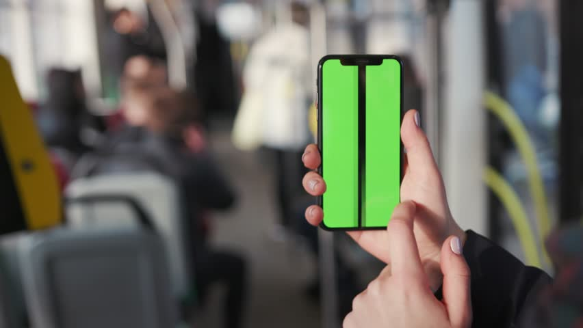 Lviv, Ukraine - May 19, 2018: Close up woman hands use touch holding a mobile telephone with a vertical green screen in tram chroma key smartphone technology cell phone street message slow motion | Shutterstock HD Video #1025899427